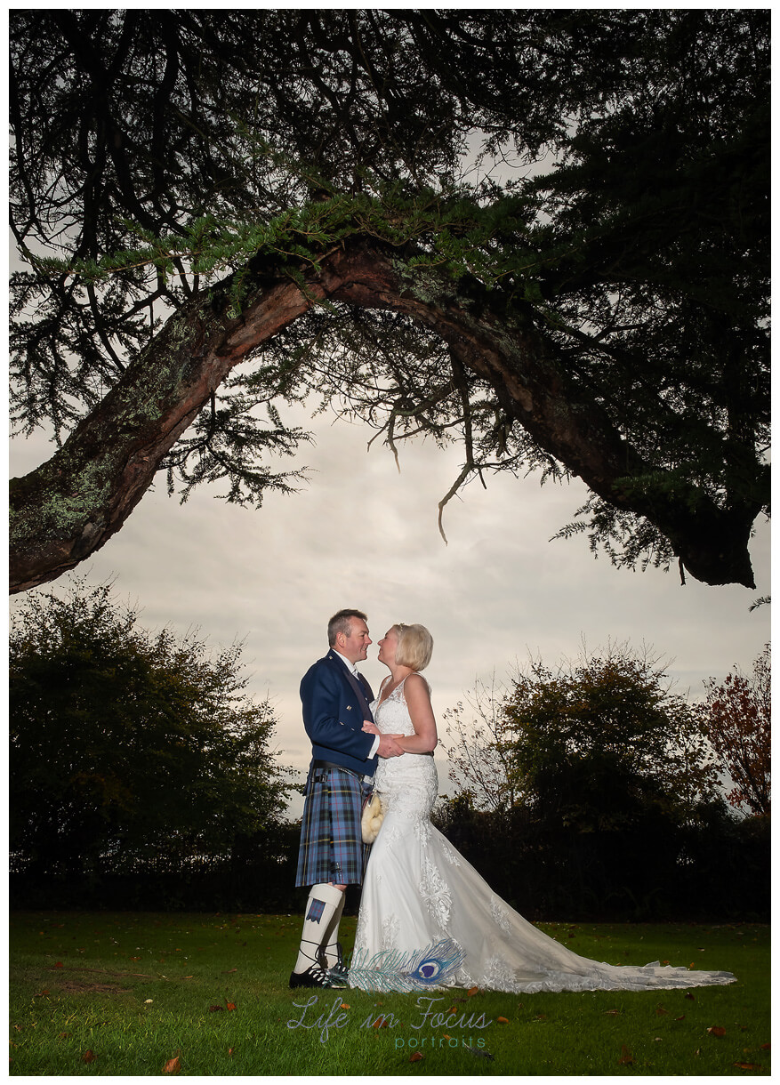 bride and groom portrait under tree wedding photo Helensburgh