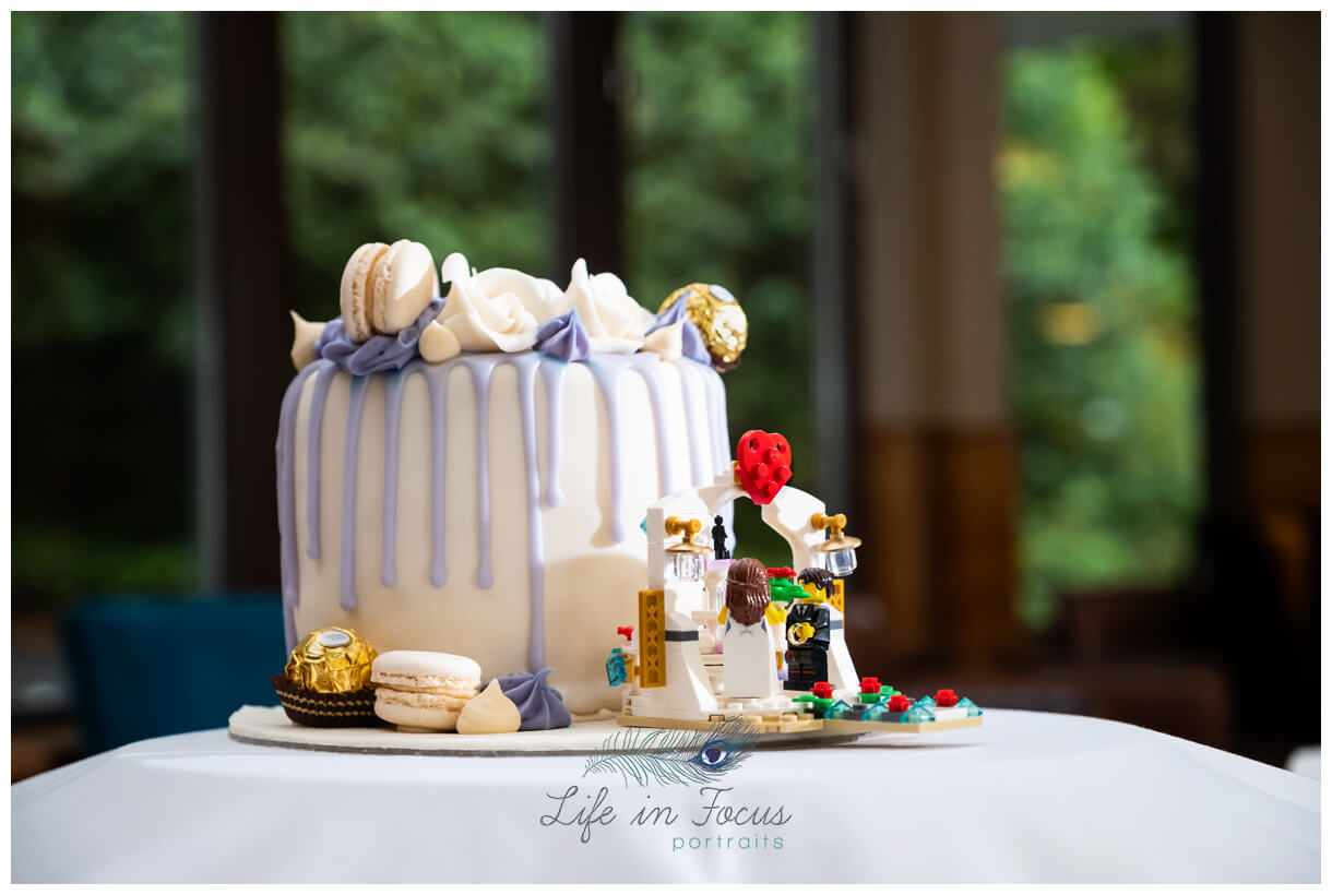 photo of wedding cake with lego figure decorations Loch Lomond wedding