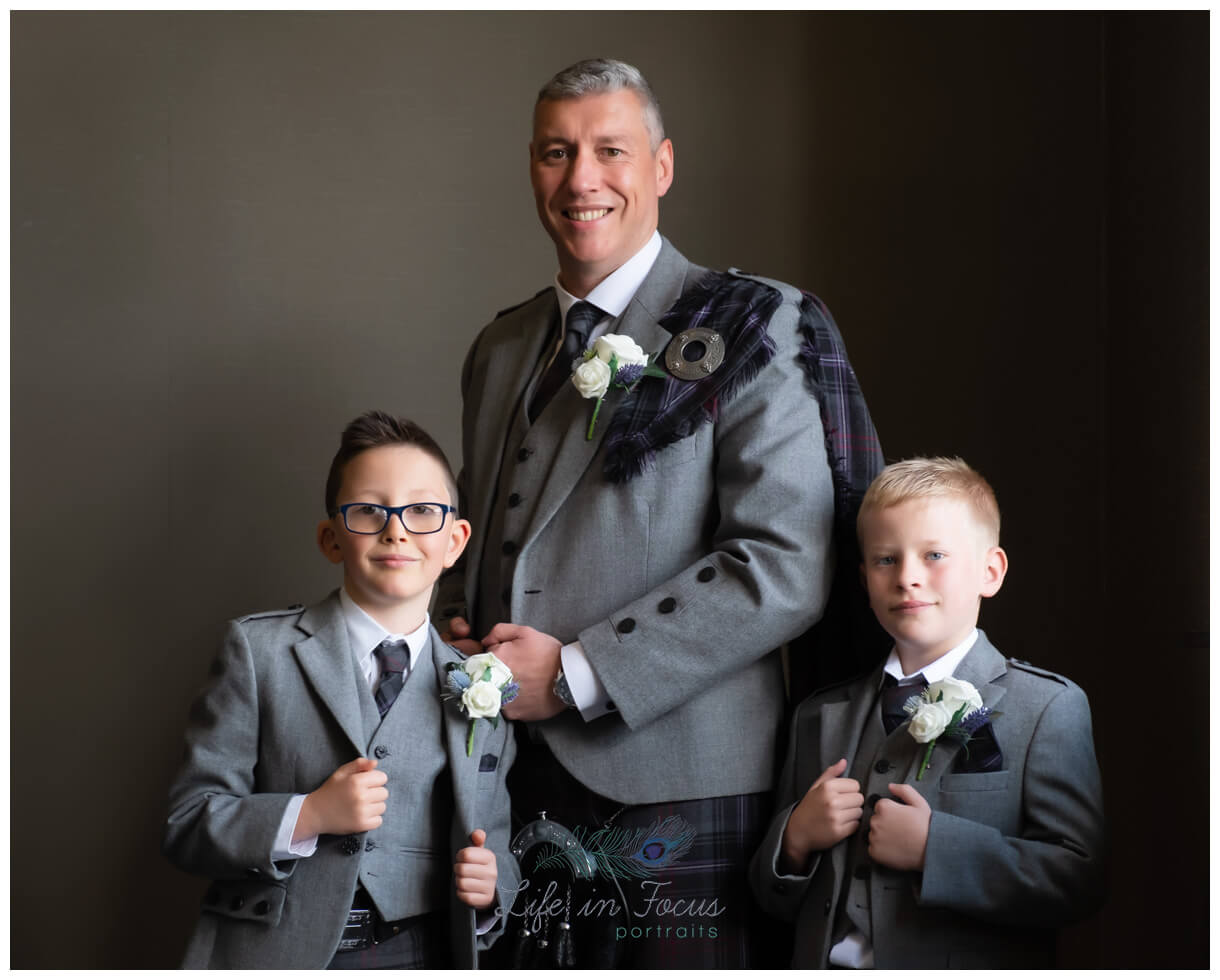 portrait photo of groom with page boys before wedding