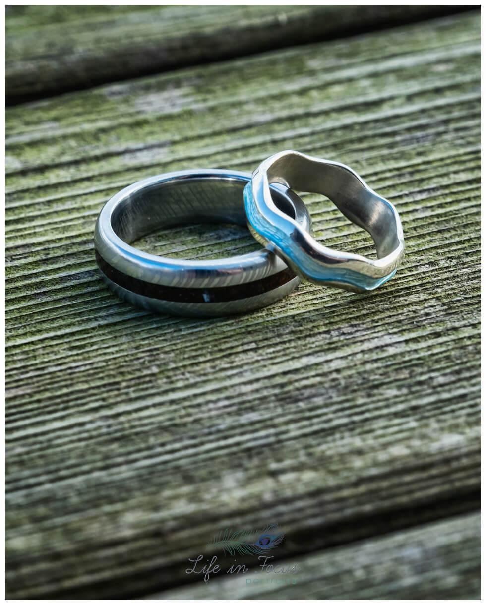 photo of wedding rings on wooden table Loch Lomond wedding