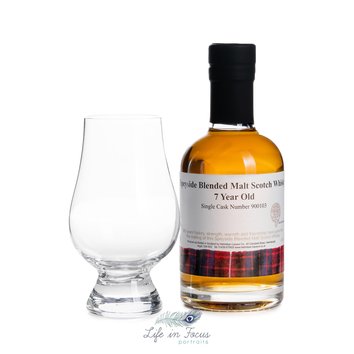 product photo of whisky liqueur with glass